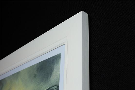White Poster Frame Corner Shot on Black Wall