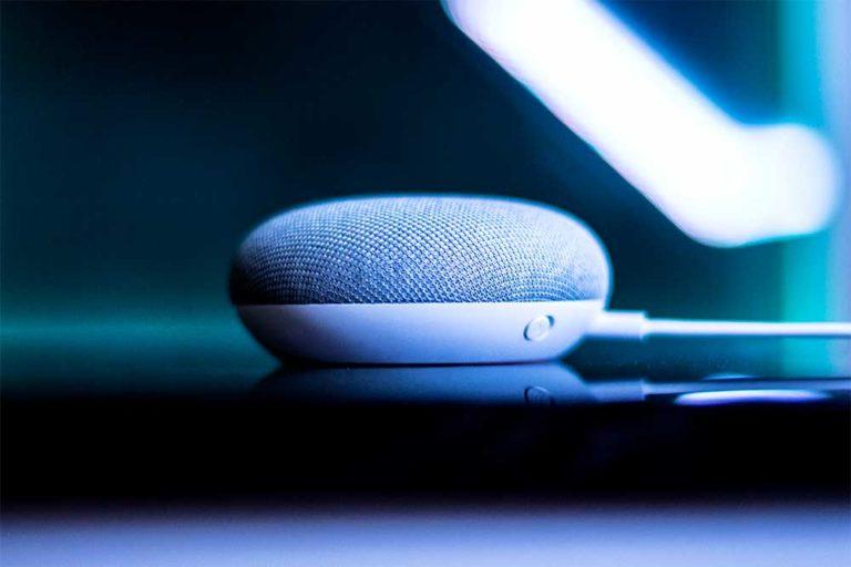 Google Home Mini with luminous blue background
